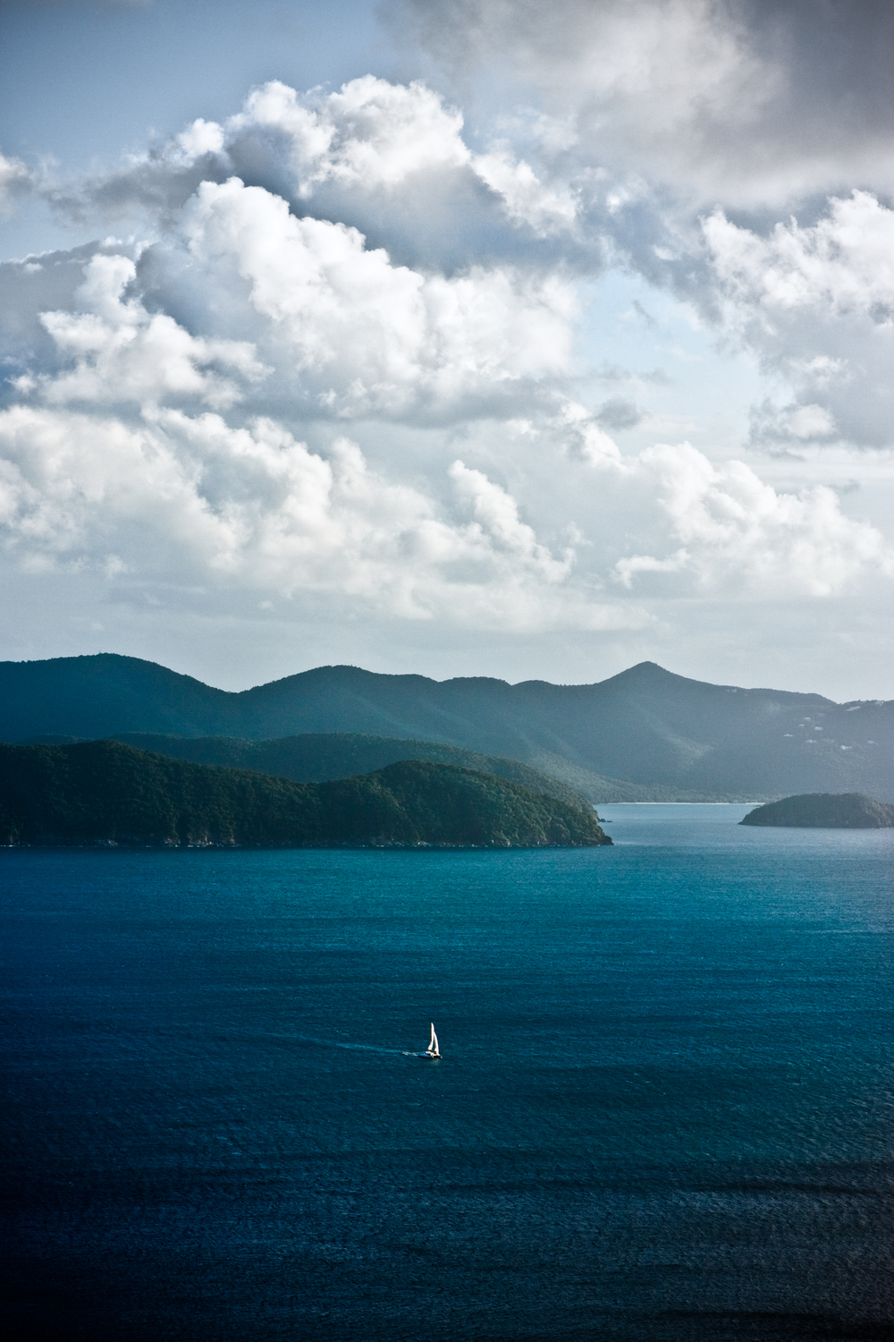 Aerial image of a sailboat under way as it crosses from Tortola to Jost Van Dyke.