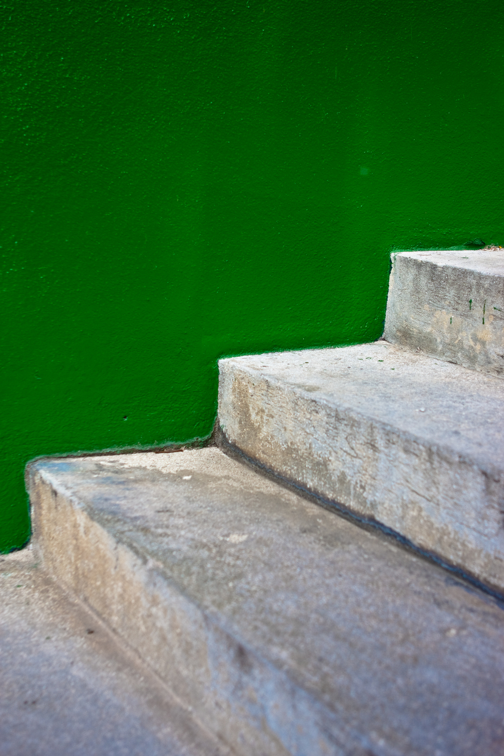 Green wall detail with stairs cutting a zig zag pattern through the foreground.