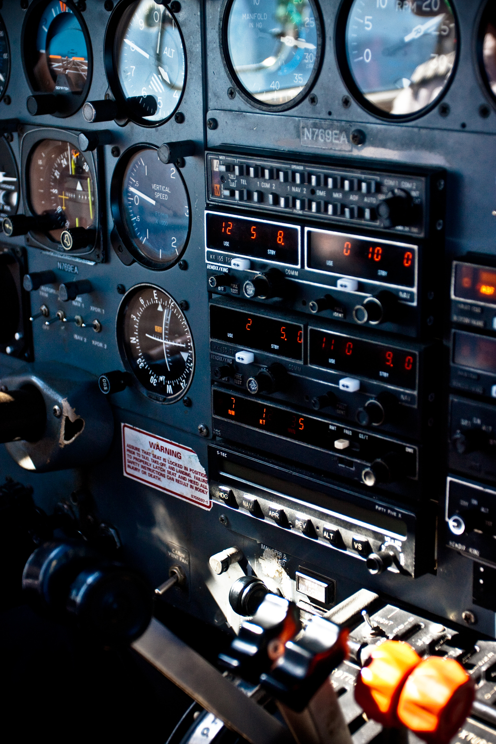 Detail shot of flight controls shot from the cockpit of a small plane.