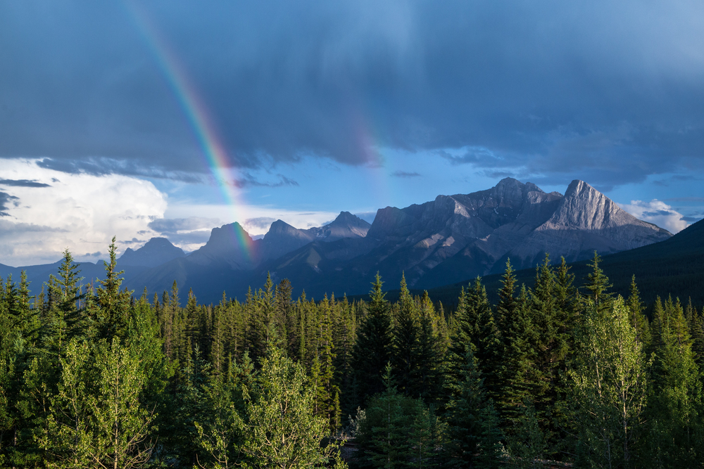 Rainbow over the Three Sisters in Canmore.