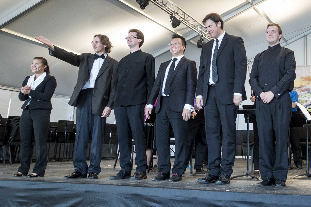 The six conductors of the inaugural Conductors' Summit take a bow and acknowledge their master instructor, Victor Yampolsky.  From the left: Deanna Tham, Fedor Ouspensky, Dan Whisler, Mark Tse, Grant Harville, and Matthew Abernathy. Photo credit: Lewis Dunn