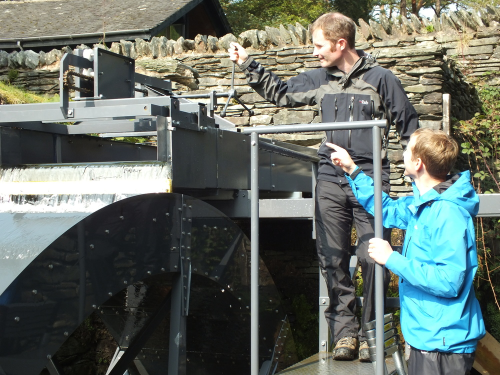 Dr Paddy Quinlan of the University of Cumbria using the adjustable launder as part of trials of the waterwheel with Jonathan Smith