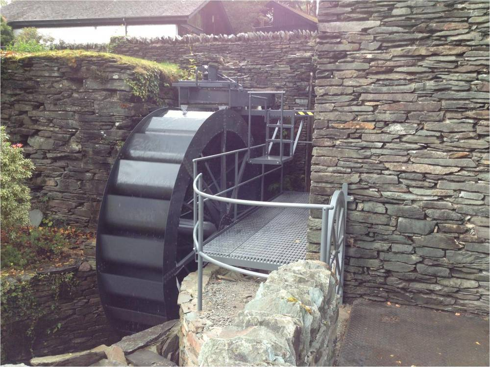 Completed waterwheel with handrail, flooring and bespoke gate, also designed and manufactured by Smith Engineering