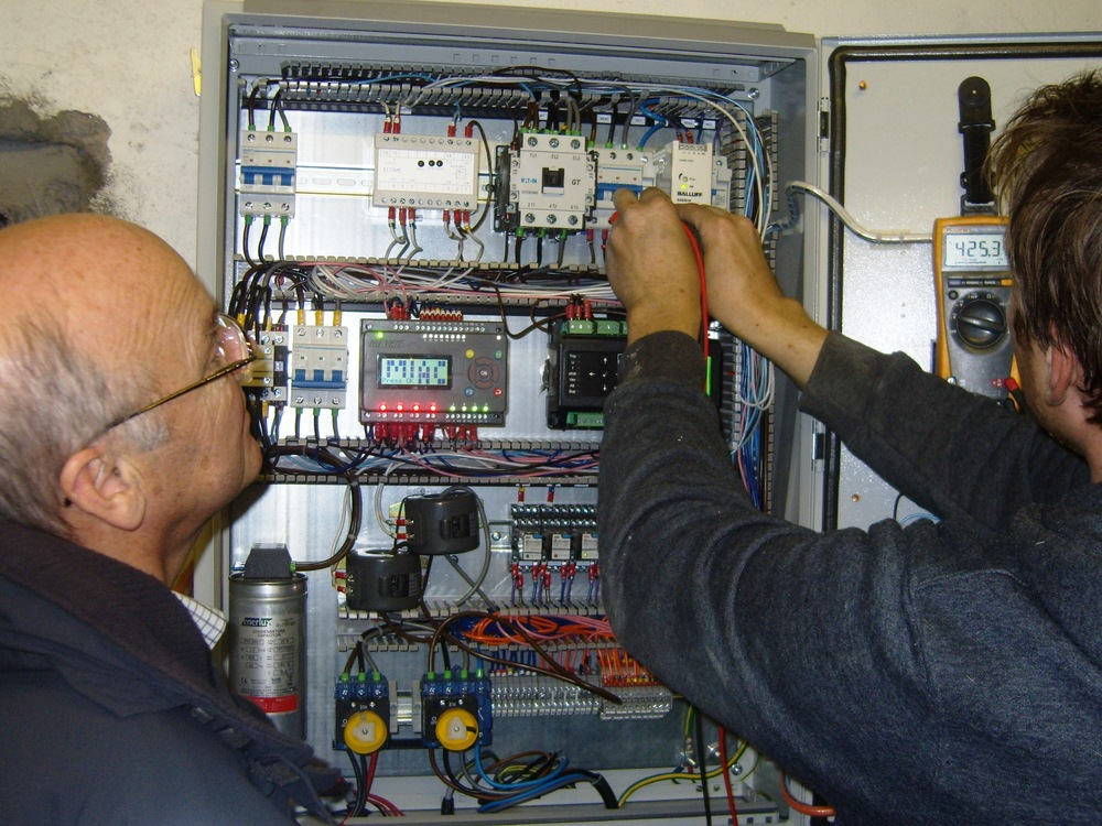 Rod Smith (l) with David Postlethwaite of Border Hydro (r) at the control panel during commissioning
