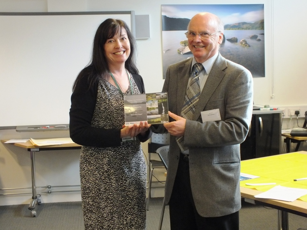 Sandra Booth, Pro Vice Chancellor from the University of Cumbria presents Rod Smith with the RETEC award for 'Journey to Commercialisation' for the Langdale Waterwheel project.