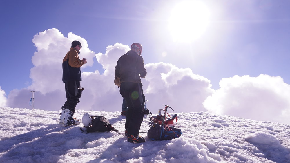 Other climbers at the summit, including a father and his son.