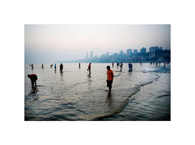 Research for teaching Bombay/Mumbai and its Urban Imaginaries (Barnard spring 2019) 🌊 | Christian Als, People paddle in the Sea off Chowpatty Beach, 2007 #mumbai #arabiansea #chowpatty