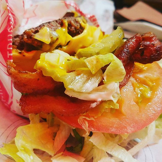 #fatburger introduces the #skinnyburger and I added bacon to it. Two patties, no bun