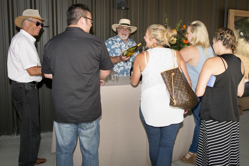 Guests enjoying wine at The Highlands Estate