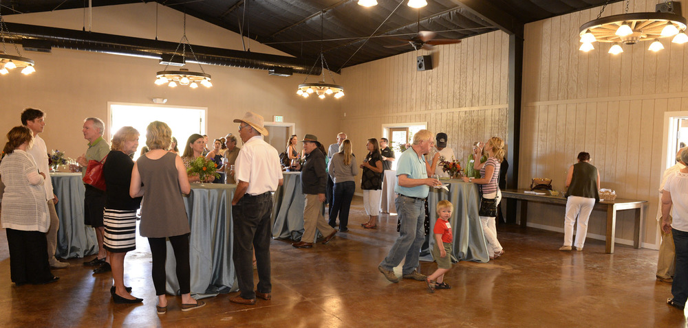 Guests mingling in the barn at The Highlands Estate