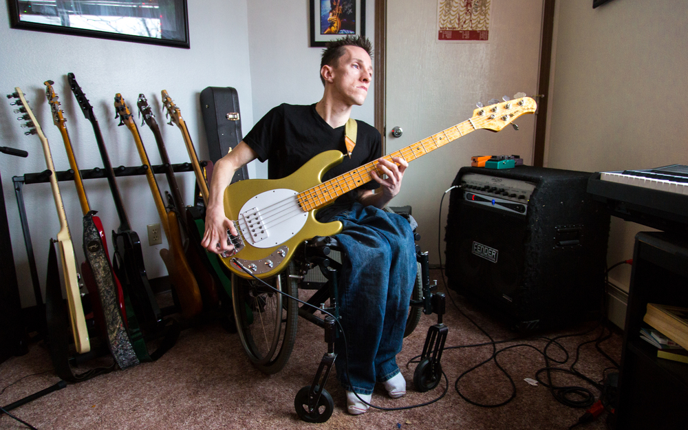 Kurt Skrivseth plays bass in his living room before a show with his band, Pale People.