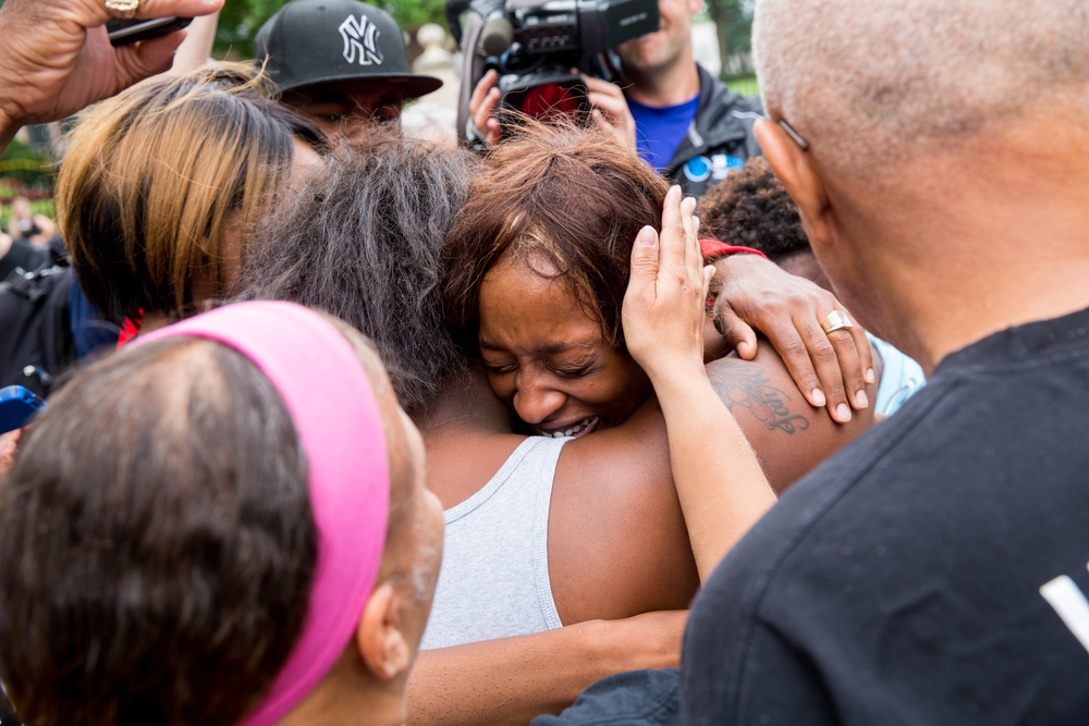 Diamond Reynolds is consoled by friends and supporters after arriving at the governor's mansion in St. Paul, Minnesota the morning after she live-streamed the police shooting of her boyfriend, Philando Castile.