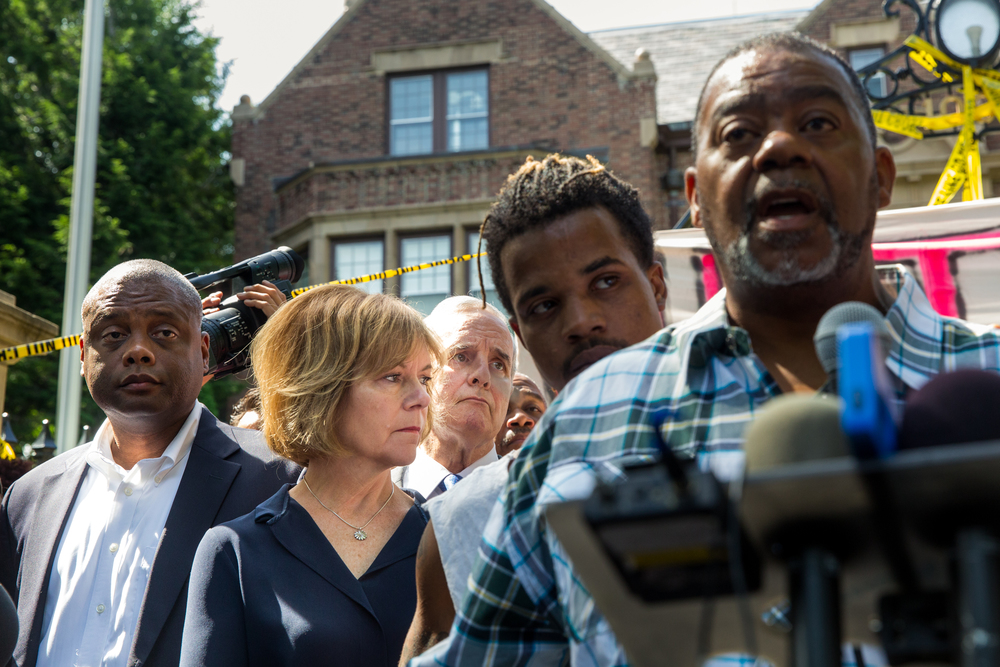 (From left) Department of Human Rights Commissioner Kevin Lindsey, Lt. Gov. Tina Smith and Gov. Mark Dayton listen while Clarence Castile speaks about the death of his nephew Philando at an NAACP press conference outside the governor's mansion in St. Paul, Minnesota.
