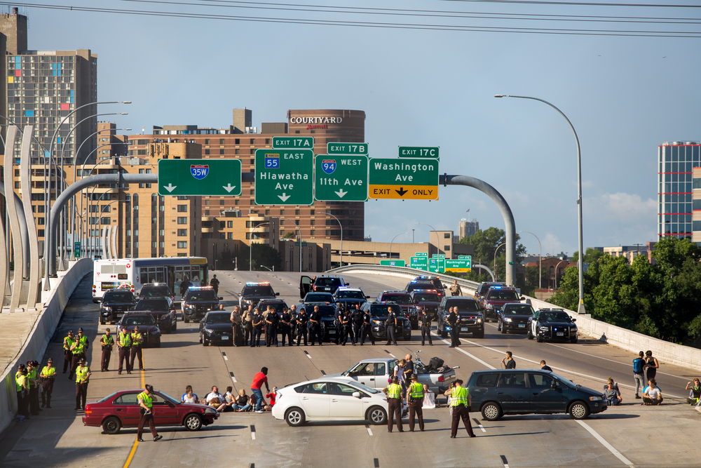 Police and State Patrol move in to make arrests during a protest on 35-W South in Minneapolis, Minnesota.