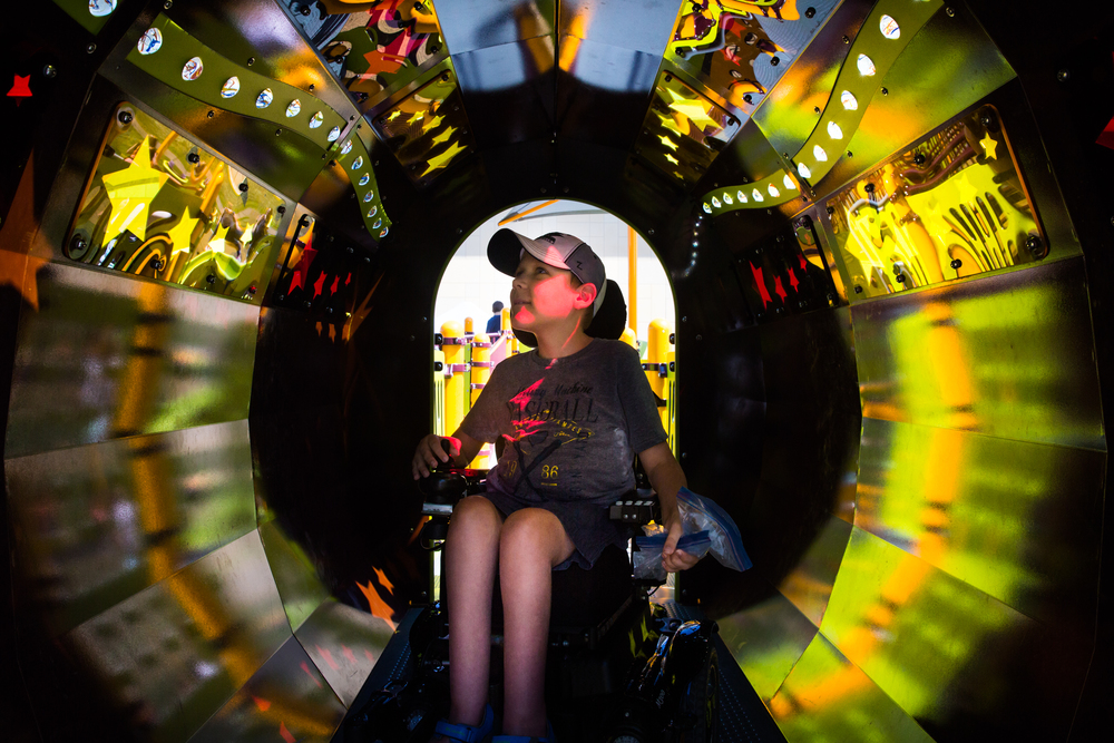 Ben Anco finds some shade in the light tunnel at Madison's Place, an all inclusive playground in Woodbury, Minnesota.