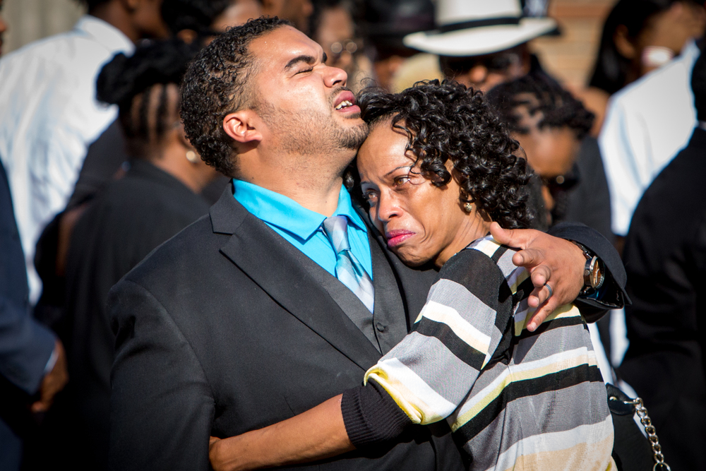 Two mourners embrace before Philando Castile's funeral.
