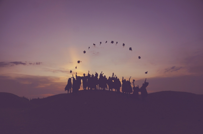Graduating College Students Throwing Their Caps into the Air at Sunset - Photo by Baim Hanif on Unsplash.jpg