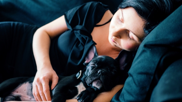 girl with dark hair sleeping with her dog Photo by Rafal Jedrzejek on Unsplash.jpg