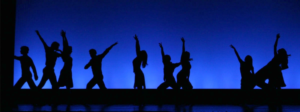 actors in silhouette on stage blue background.jpg