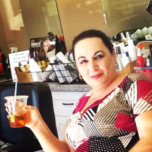 Rema, our rockstar #esthetician, beating the heat with a chilly iced tea.