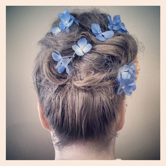 the back view of our #lovely lady's 50's #wedding #hairstyle! #love the #blue #flowers - they're real!
