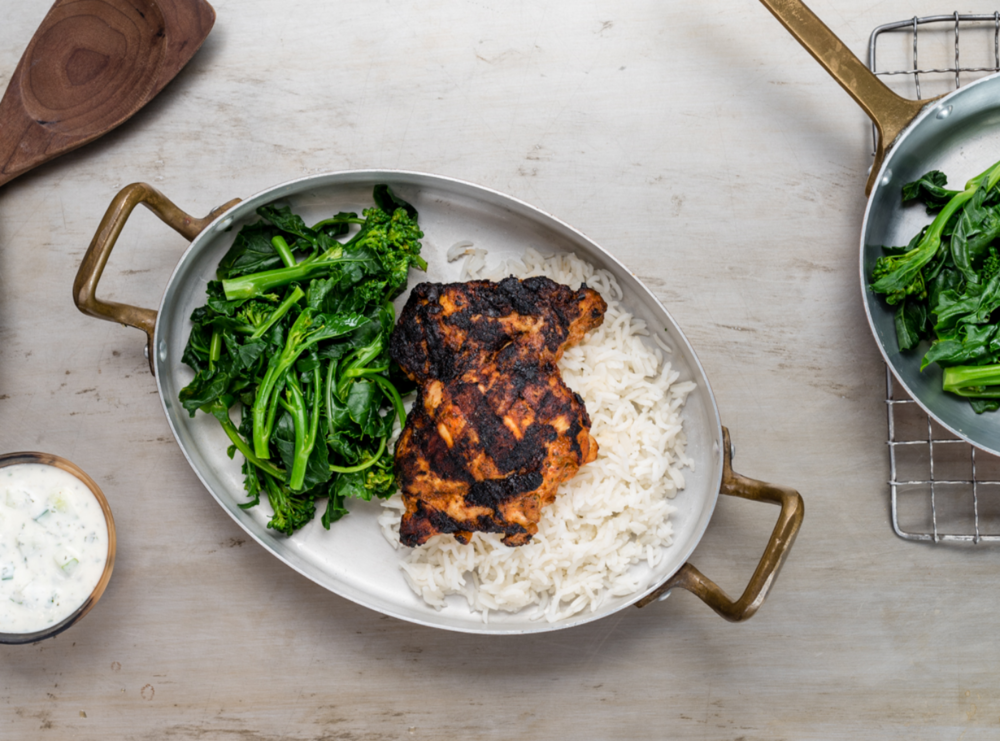 Yogurt chicken with paprika, rice and roasted sprouting broccoli
