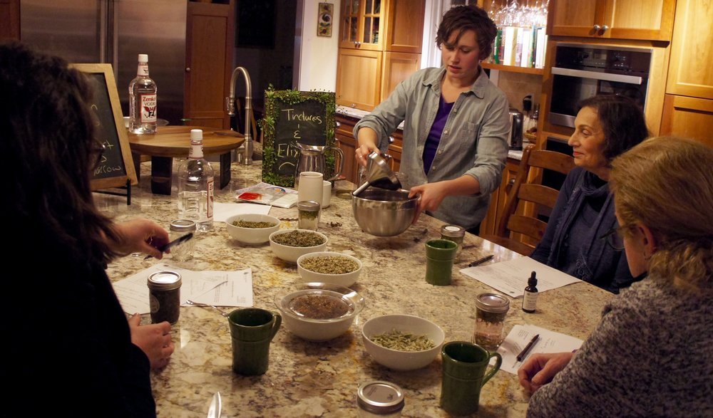 Straining a tincture in tincture-making class
