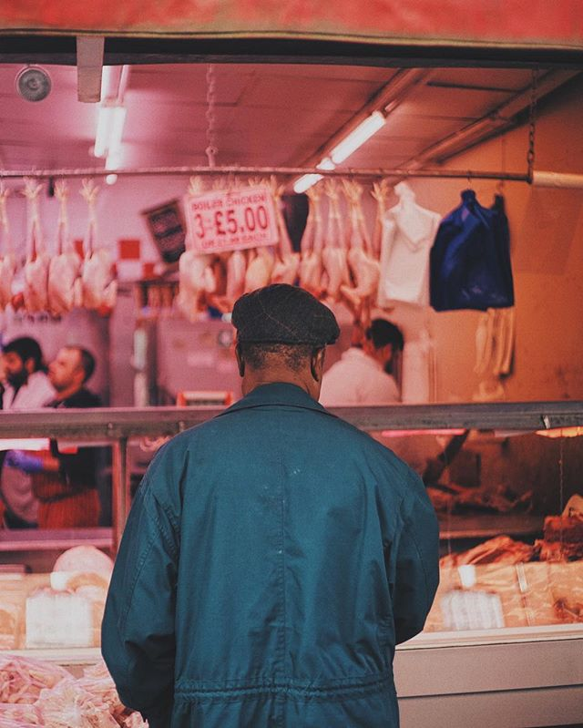 An old man standing in front of a butcher , Brixton , London 2016 #photographer #london #brixton #butcher