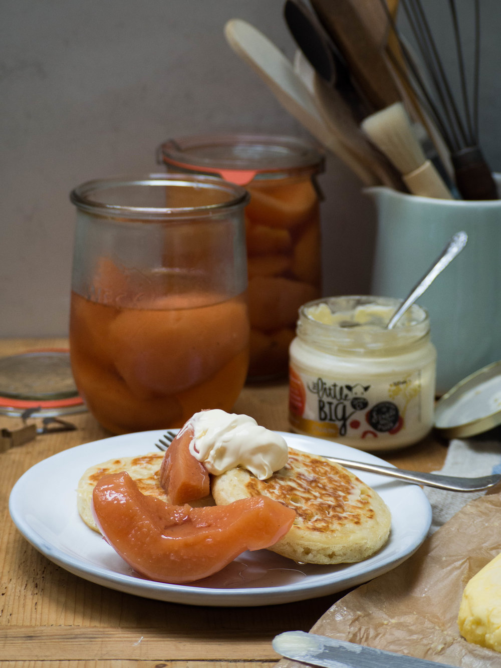 Buttermilk Crumpets with Homemade Butter, Poached Quince & Cream