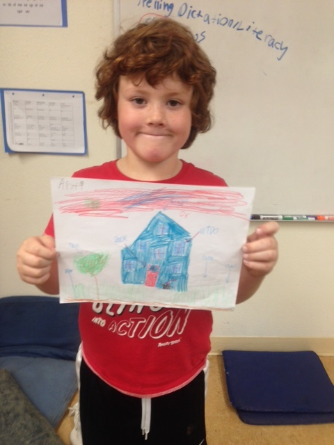 One of Elsie's 2nd graders with his labeled drawing of his house to send to his Panama pen pals.