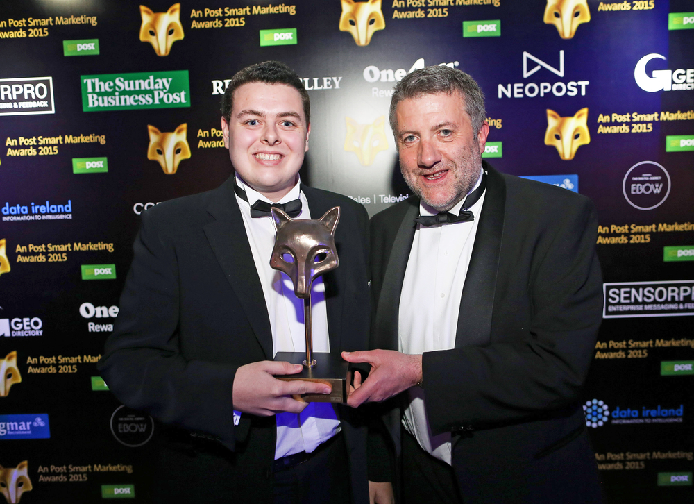 Paul Cooke, CEO of The Sunday Business Post, presenting Padraig O'Connor with the An Post Smartest Student Marketing Campaign of the Year' award for 'The Business of Keeping Ahead Campaign'.