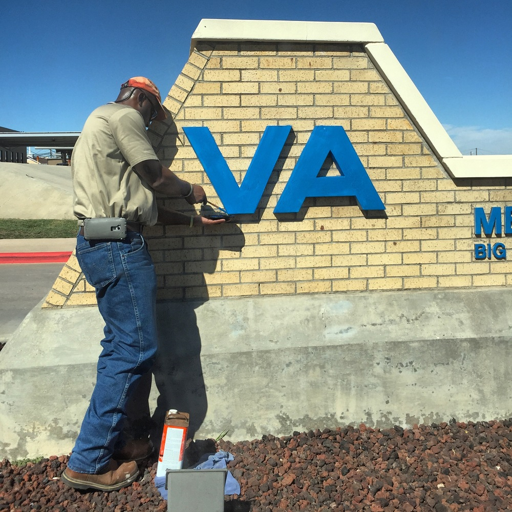 October, 2015. Big Spring, TX. A man repaints the letters at the entrance of the VA Medical Center in Big Spring. This hospital serves 33 counties across the rural landscapes of West Texas and Eastern New Mexico.   #SnapshotLives   #veterans     #health