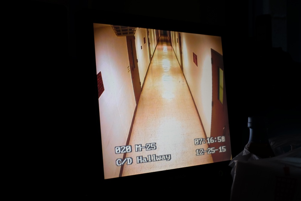 A screen shows one of the main hallways in the Midland County jail on Christmas Day, 2015.