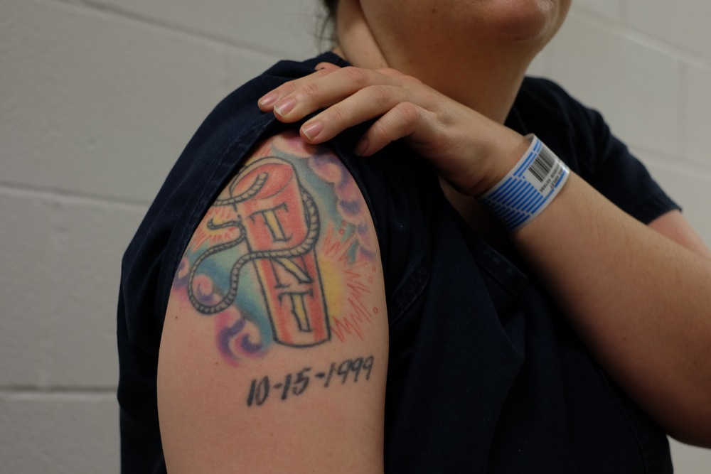 An inmate shows her tattoo. The date is the date when her mother died. This is her first day in Midland County jail. She had just been transferred after a year in TDC. Christmas Day, 2015.