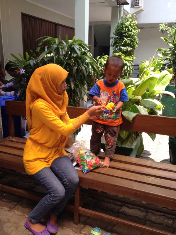 Syahrial's wife playing with their 2 year old son