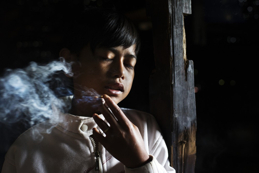 Michelle Siu (Michelle Siu did a powerful collection of photographs depicting young smoking in Indonesia).