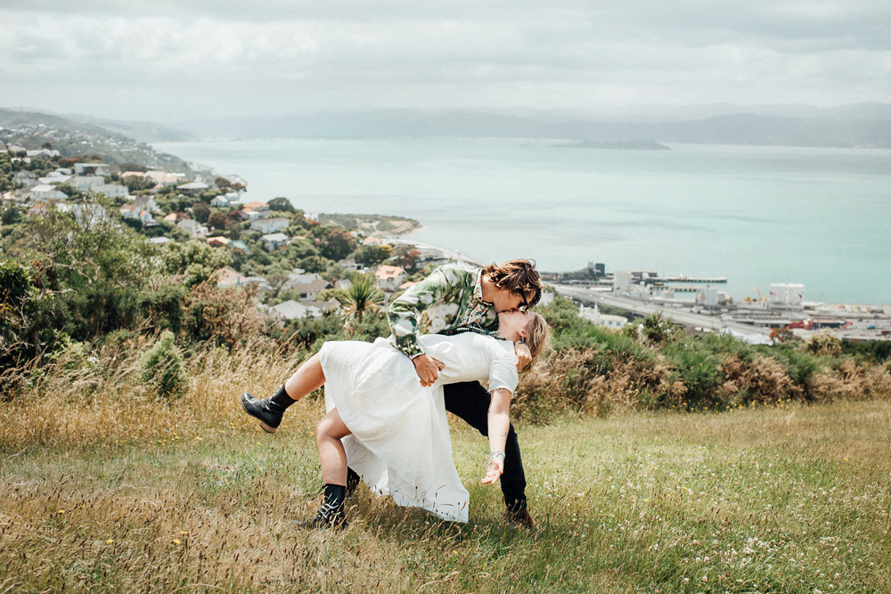 Wedding photography Wellington hilltop ceremony kiss