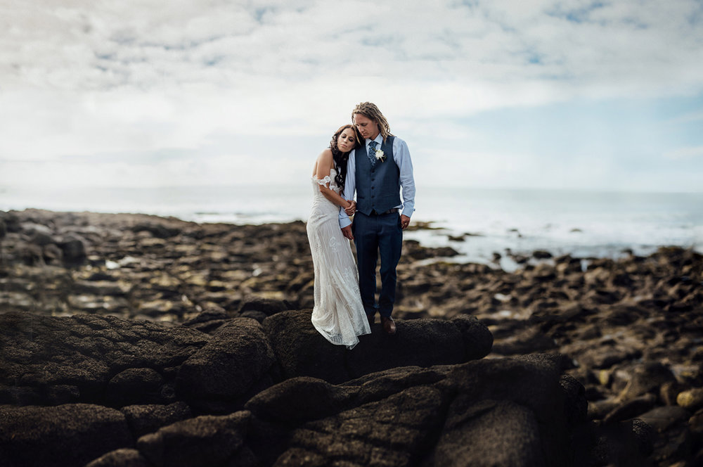 Wedding photography bride and groom beach rocks brenzier Raglan Waikato