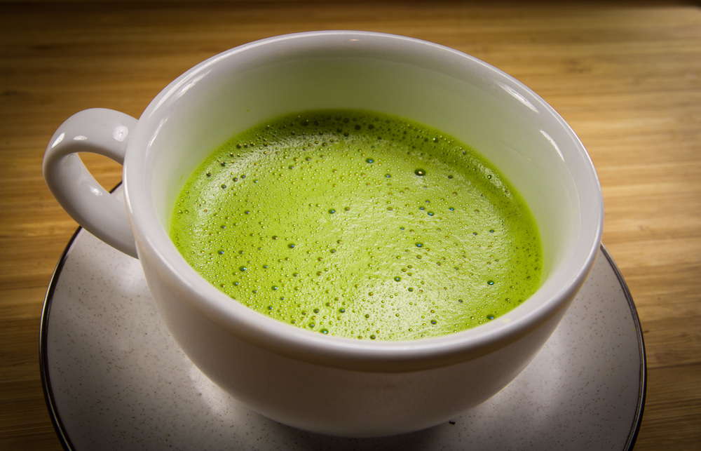 cup of matcha green tea in white bowl