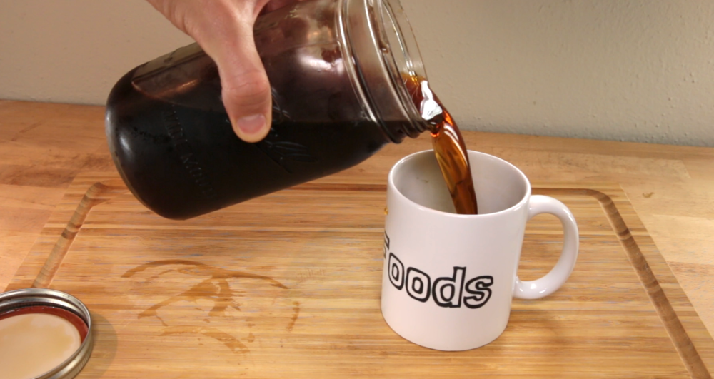 pour cold brew into mug