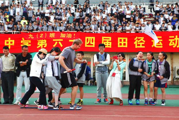 Annual Sports Day 2014. I am participating in a relay race with a student and a fellow English teacher.