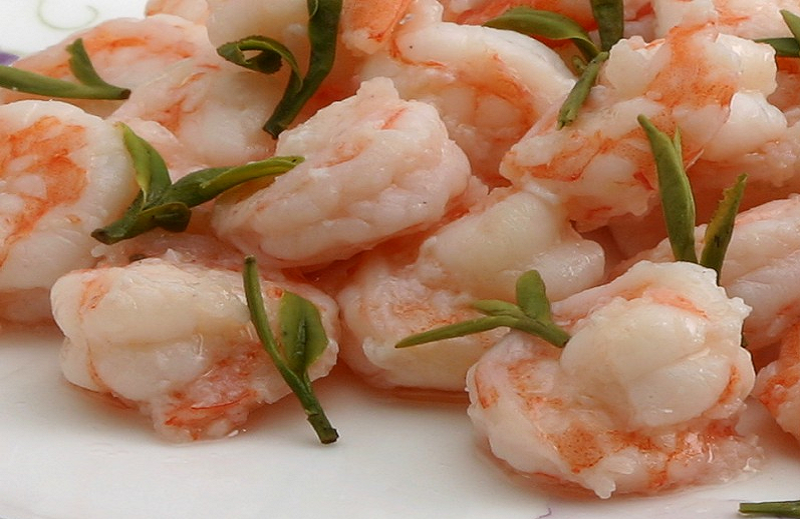 The Longjing tea shrimp is a delicacy, and it known for its subtle tea accent.  If you're feeling adventurous the drunken shrimp offers live shrimp in an liquor based sauce.