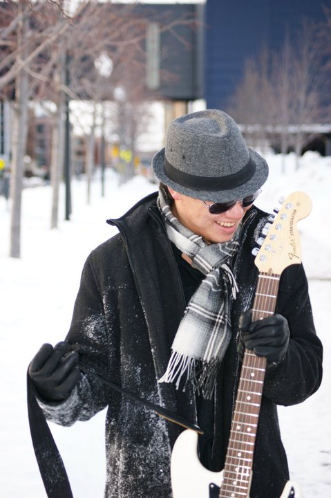 Jon rocking his beloved American-made Fender Stratocaster... in the snow-covered streets of his native Minnesota landscape! Photography by Mike Bullard.