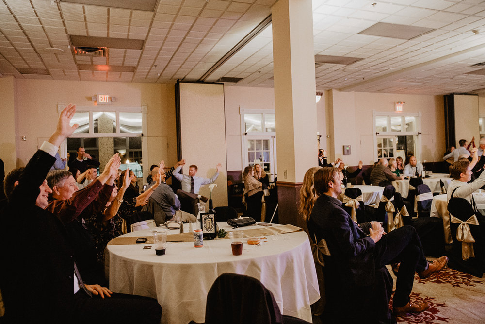 wedding guests waving their hands in the air.jpg