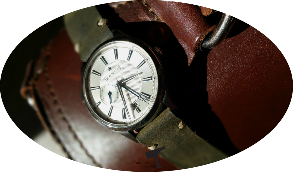 The Worn & Wound Model 2 Horween Leather strap in Olive, atop my Saddleback Leather front pocket briefcase.