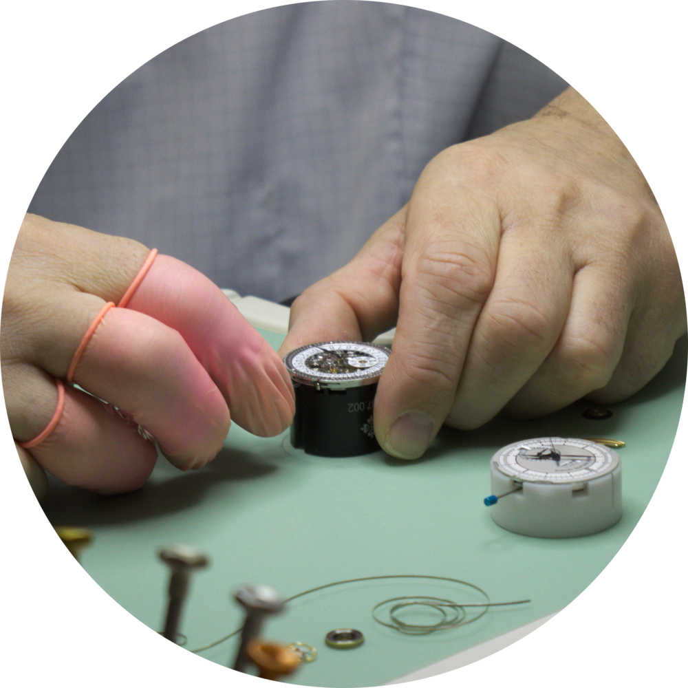 Technician inspecting Patek movement