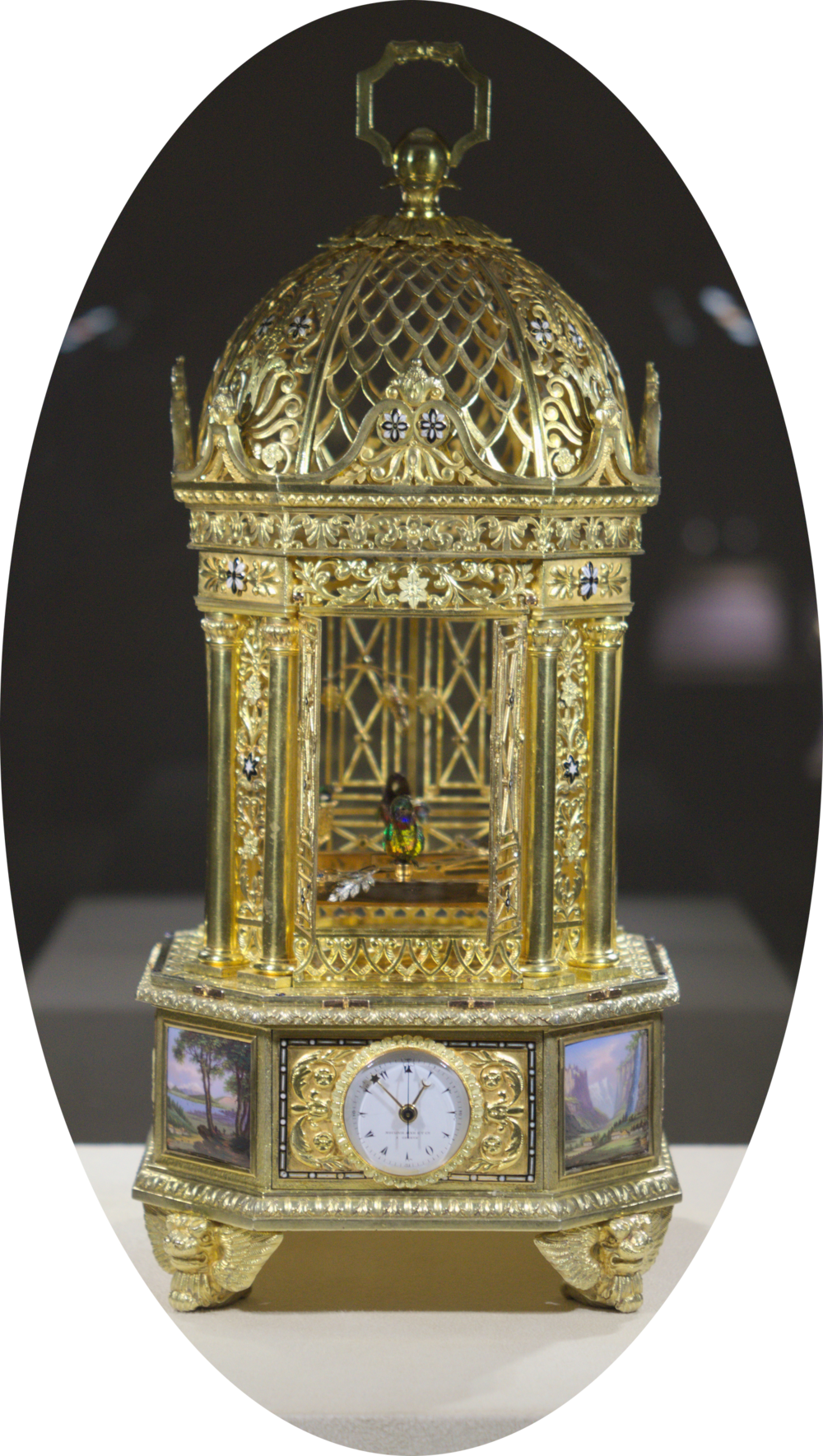 ex·trav·a·gant. ikˈstravəɡənt/.  adjective. Example:  A solid gold case with enamel detailing with Grande Sonnerie, Petite sonnerie, music and a singing bird. Each of the five birds are activated either every hour or on demand with the larger two turning their heads, opening & closing beaks, flapping their wings, tail and jumping between the two bars. The three yellow birds move their heads and open their beaks.