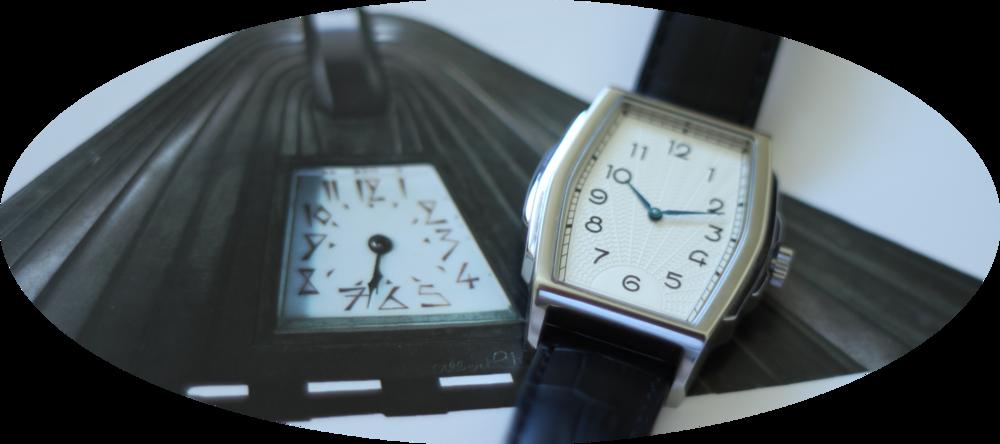 The Kent Wang Art Deco watch and an Albert Cheuret bronze and onyx mantle clock