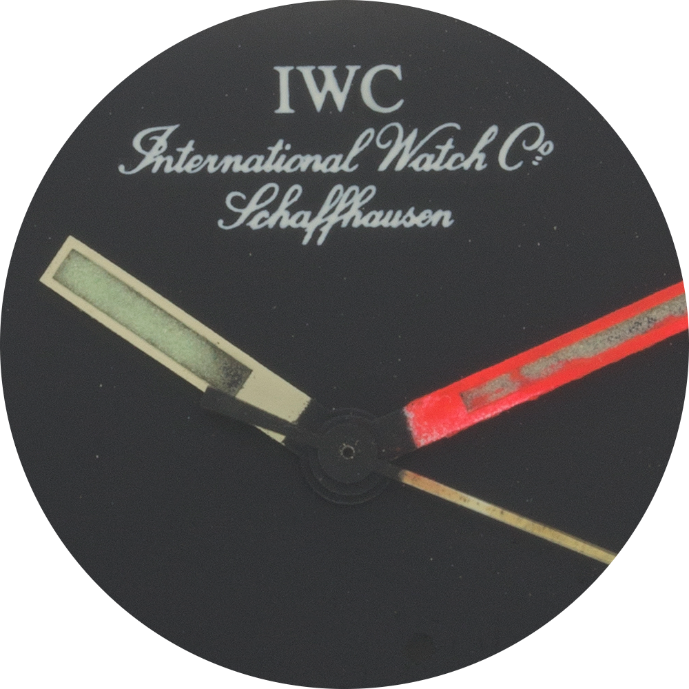 IWC name and hands close up.png