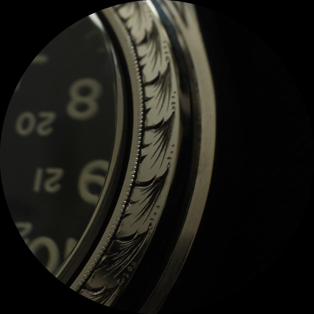Field watch case engraving macro 1.png
